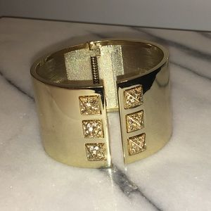 Gorgeous gold statement bangle with crystal